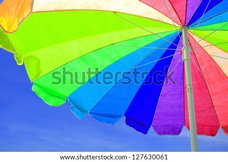 Colorful Beach Umbrella at beach - stock photo