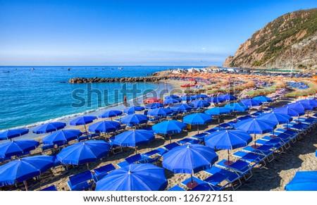 Colorful beach umbrella at the Monterosso beach, Cinque Terre,Liguria, Italy - stock photo
