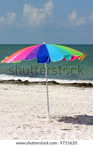 Colorful beach umbrella on Madeira Beach  Florida - stock photo
