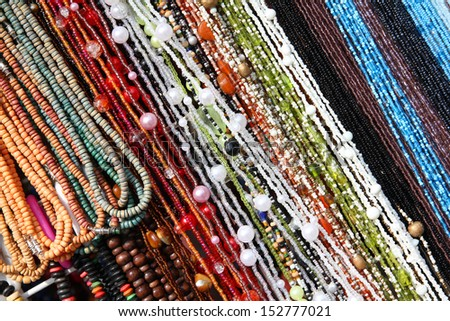 Colorful beads background - necklaces at a store. Abstract jewellery. - stock photo