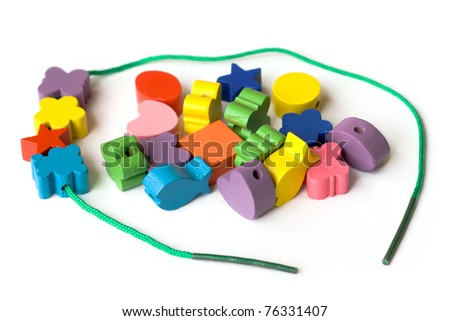 Colorful beads for handicrafts on a white background - stock photo