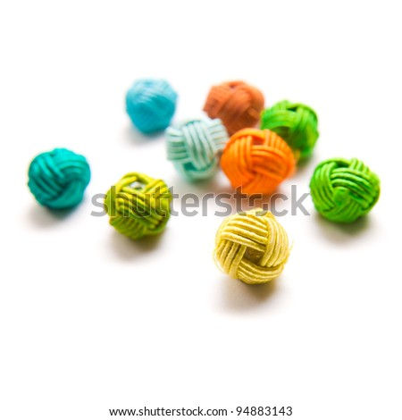 "colorful beads in ""knotted"" style, isolated on white"
