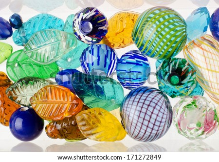 Colorful beads on white - stock photo
