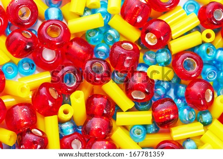 Colorful beads on white background, macro
