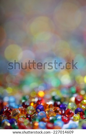 Colorful beads with beautiful blurry background - stock photo