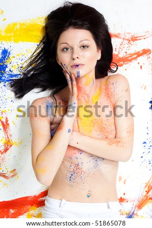 Colorful beauty woman painted in red yellow an white - stock photo