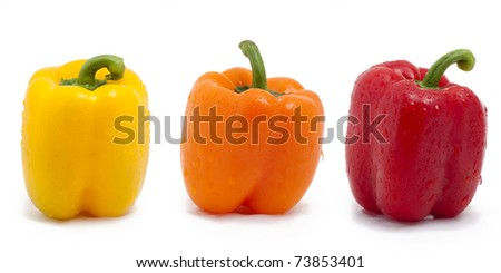 Colorful bell peppers on white.