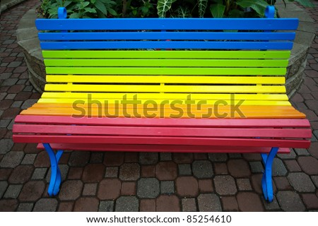 Colorful bench at the park - stock photo