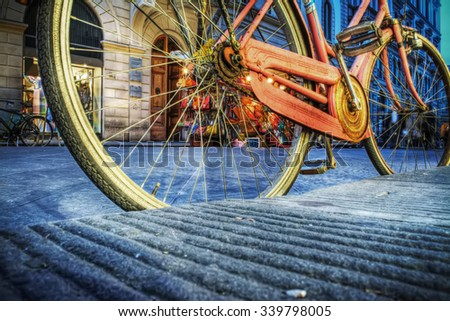 colorful bicycle on the edge of the road in Florence, Italy - stock photo
