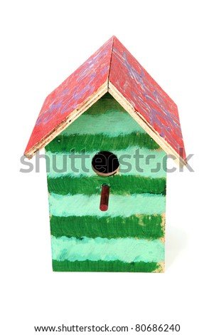 Colorful birdhouse painted by children over white background - stock photo