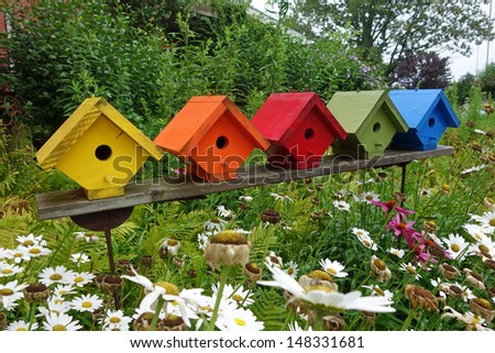 Colorful birdhouses in the garden - stock photo
