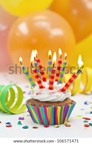 Colorful birthday candles and balloons - stock photo
