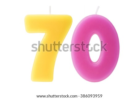 Colorful birthday candles in the form of the number 70 on white background