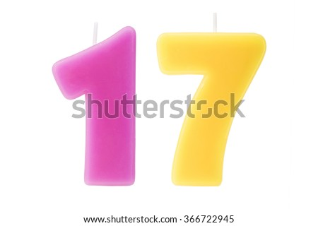 Colorful birthday candles in the form of the number seventeen on white background