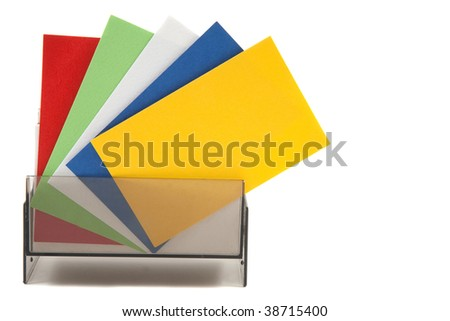 Colorful blank name cards in a box and spread out - stock photo