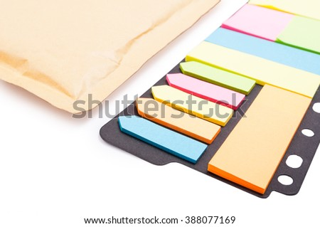 Colorful blank post-it paper in closeup on white background as memo and reminder label concept - stock photo