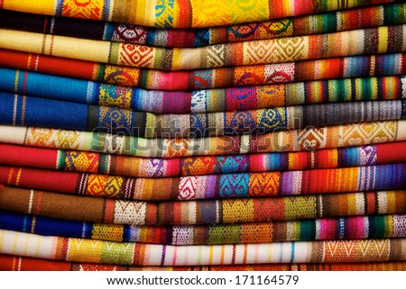Colorful blankets for sale in market in Otavalo, Ecuador - stock photo