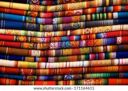 Colorful blankets for sale in the market in Otavalo, Ecuador - stock photo