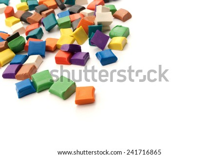 Colorful blocks of plasticine over white background. - stock photo