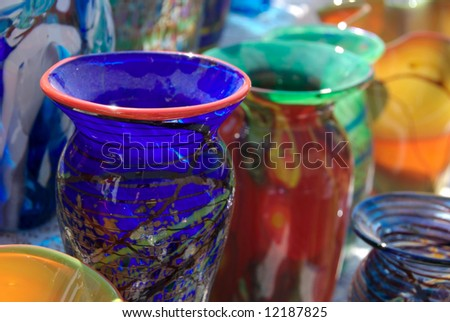 Colorful blown vases and glassware on display