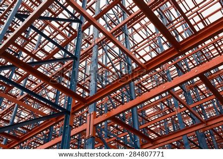 Colorful blue and red scaffolding. - stock photo
