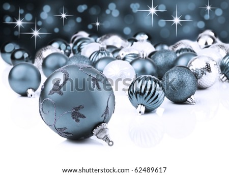 Colorful blue christmas decoration baubles on white with space for text - stock photo