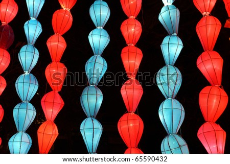 colorful blue red lantern with night scene - stock photo