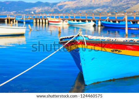 Colorful boat on water, in Aitoliko sea lake in Central Greece - stock photo