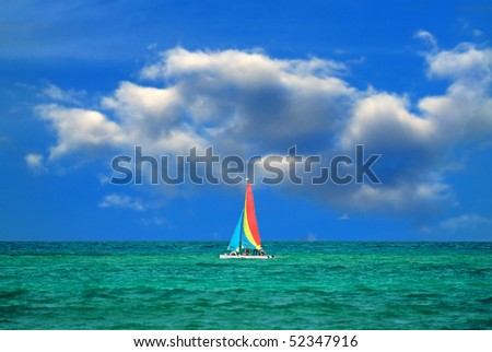 Colorful boat sailing across the carribean sea - stock photo