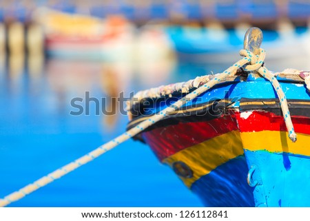 Colorful boat with rope, in Aitoliko sea lake in Central Greece - stock photo