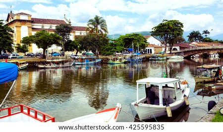 colorful boats in the bay of the famous historical town Paraty, Brazil  - stock photo