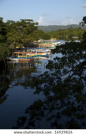 Colorful boats on Black river, Negril, Jamaica - stock photo