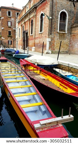 colorful boats transportation with Ancient Building in Venice Canal, Italy - stock photo