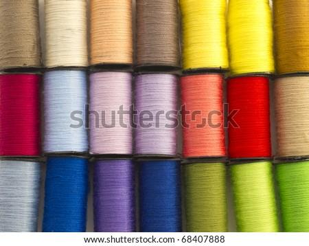 colorful bobbins background - stock photo