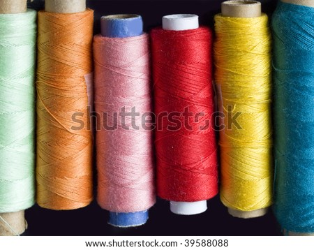 colorful bobbins in the line - stock photo