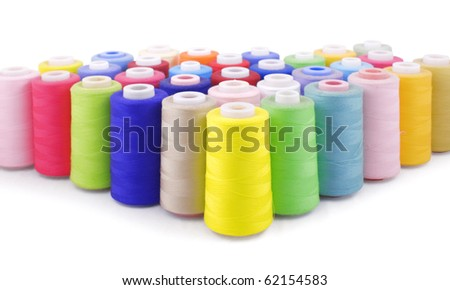 colorful bobbins isolated on white with clipping path - stock photo