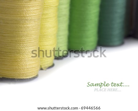 colorful bobbins with the place for your text - stock photo