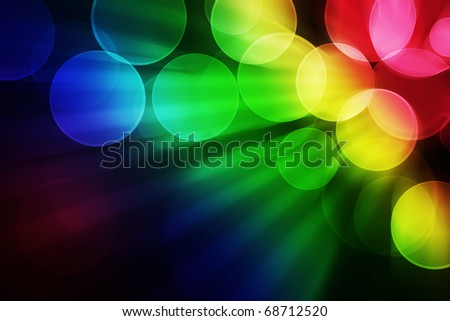 colorful bokeh effect background with spots and rays - stock photo