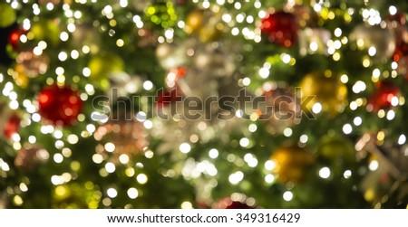 Colorful bokeh effect of christmas lights - stock photo
