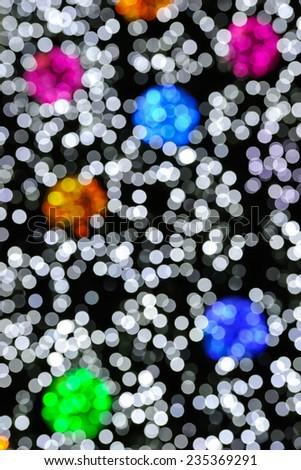 Colorful bokeh of christmas lights. - stock photo
