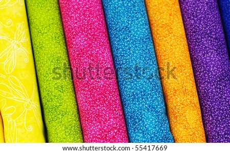 Colorful bolts of fabric - stock photo