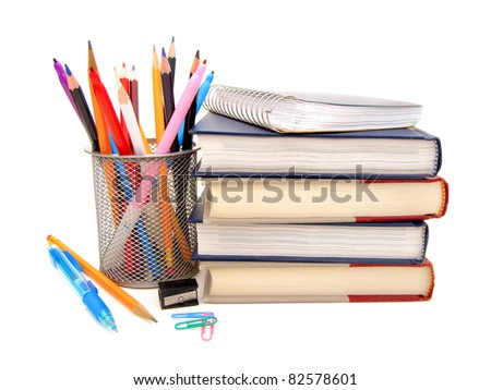 Colorful border of an assortment of school or office supplies on a white background - stock photo