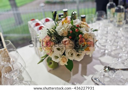 Colorful bouquet of flowers on the wedding table - stock photo