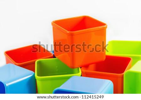 Colorful boxes on white background, orange on top - stock photo