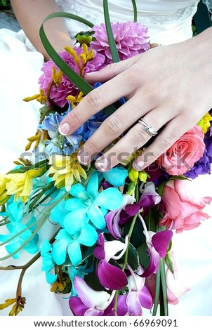 Colorful Bridal Bouquet with Engagement Ring - stock photo