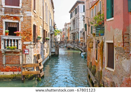 Colorful bridge across canal in Venice, Italy - stock photo