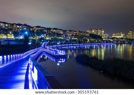 Colorful Bridge and cityscape at night in Korea.