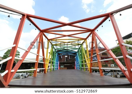 Colorful bridge in a wide angle shot with blue sky in a sunny day