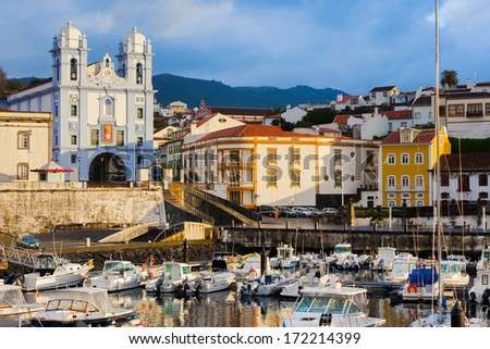 Colorful, bright view on the city Angra do Heroismo, Terceira island, Azores islands. Good for postcards. Early morning after storm. - stock photo