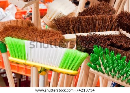 Colorful broom heads - stock photo
